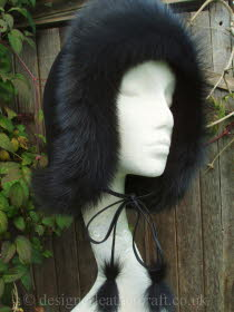 Black Toscana Shearling Hat Worn as a Hood