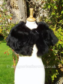 Black Toscana Shearling Wrap Fastens with a Loop and Toggle